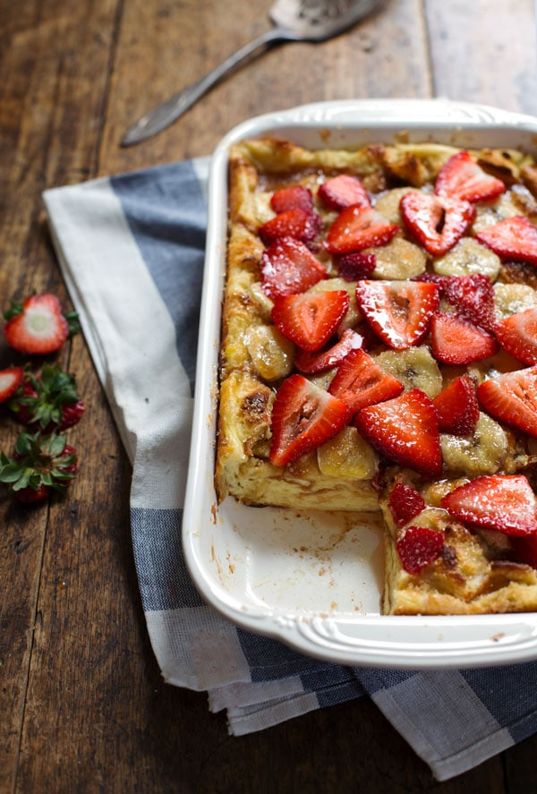 Coconut French Toast Bake with strawberries in a white dish.