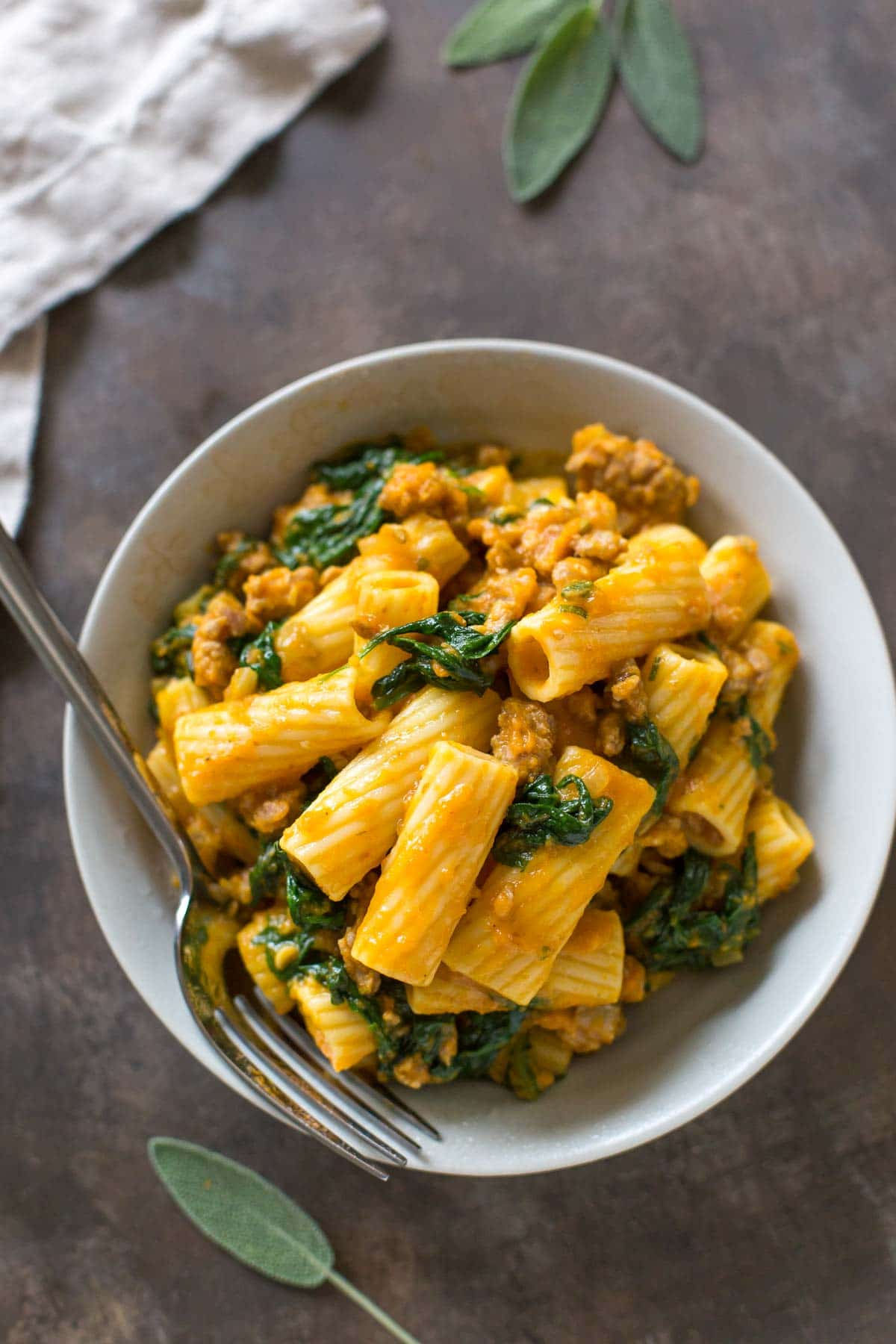 Pumpkin Rigatoni with Italian Sausage & Spinach | Savory pumpkin recipes, dairy free pasta recipe, easy dinner recipe, pumpkin recipe, pasta dinner recipe, fall dinner ideas | @simplywhisked
