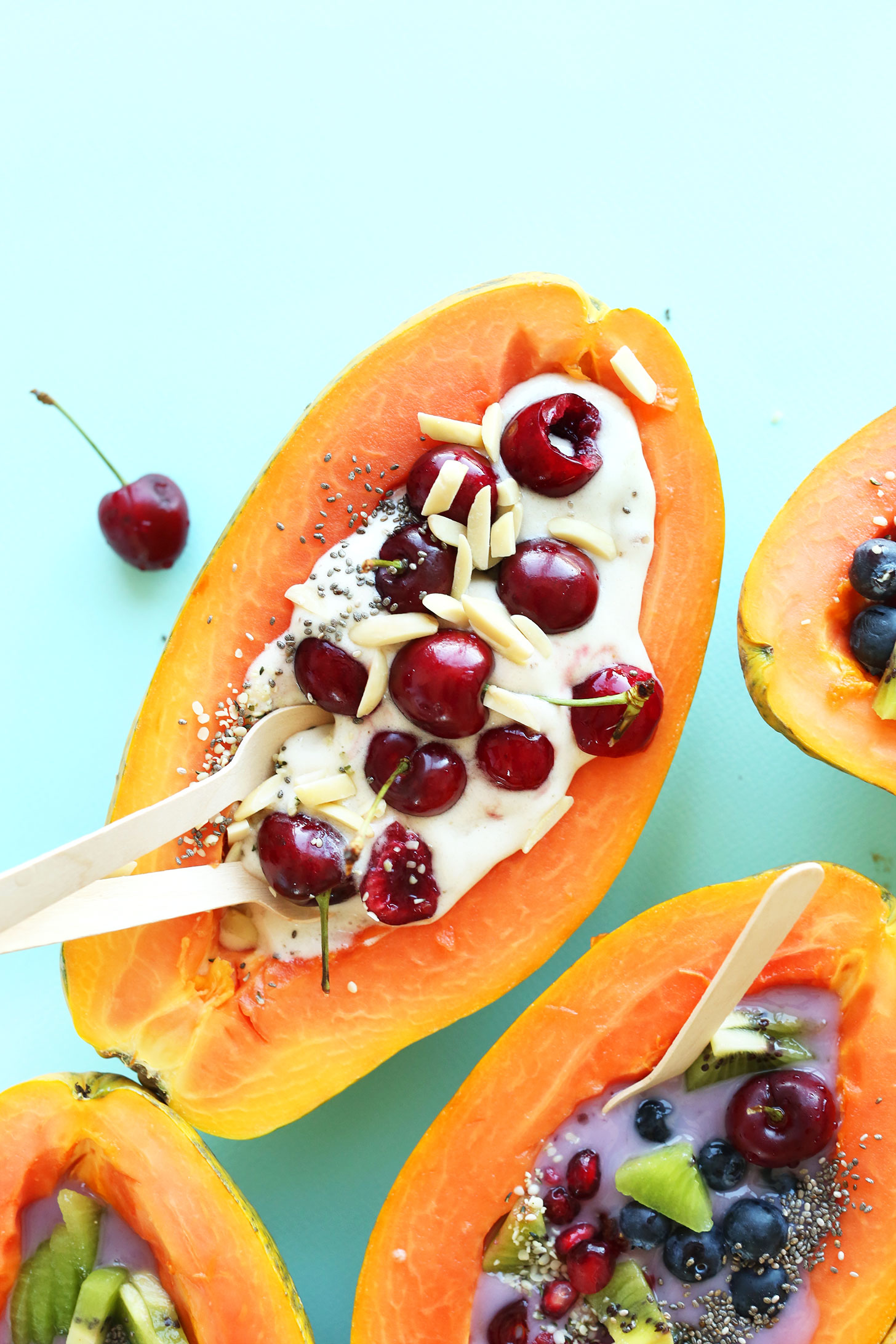Papaya Boats with delicious summer toppings for a gluten-free vegan snack