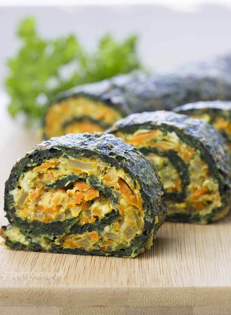 Vegetarian Spinach Roll on a wood cutting board