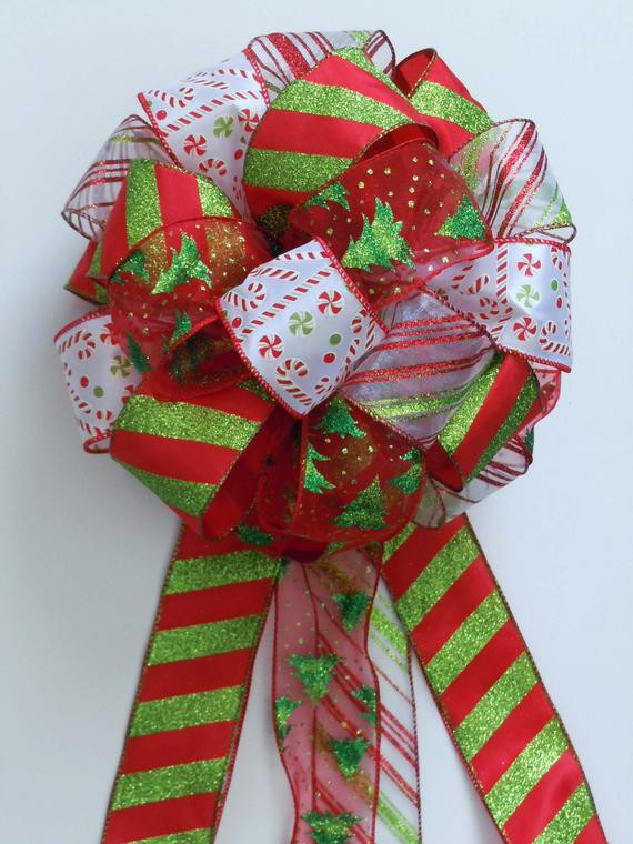 Candy Christmas Tree Topper  Items similar to Christmas Bow Tree Topper Bow Candy Cane