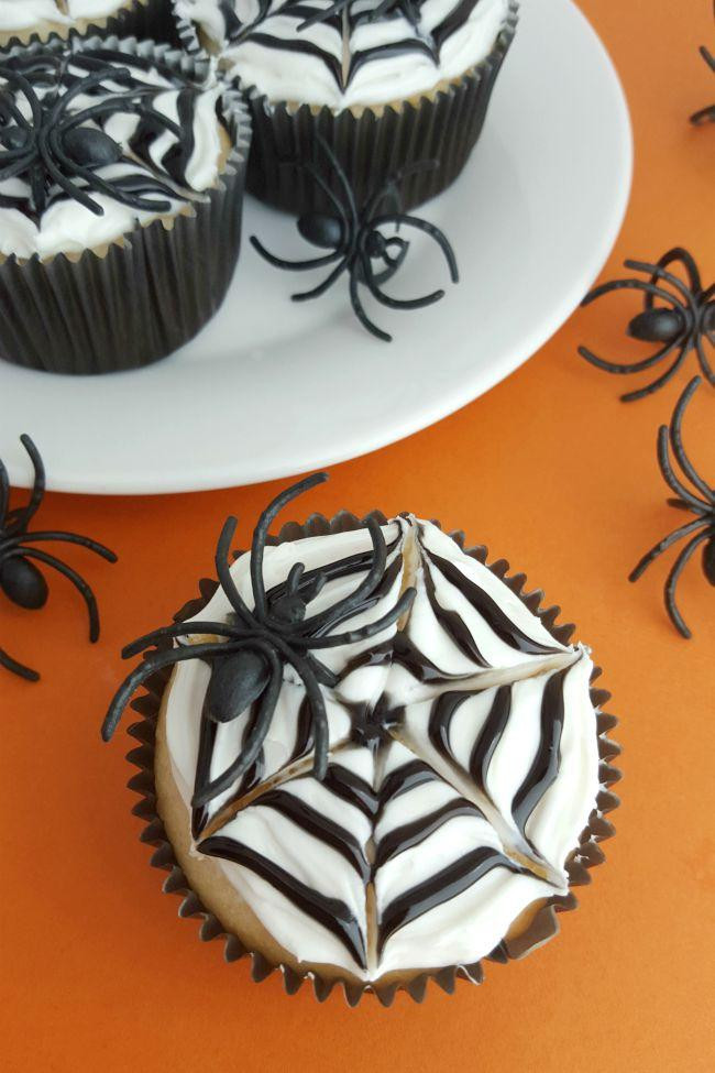 Cool Halloween Cup Cakes  Spider Web Cupcakes Spaceships and Laser Beams