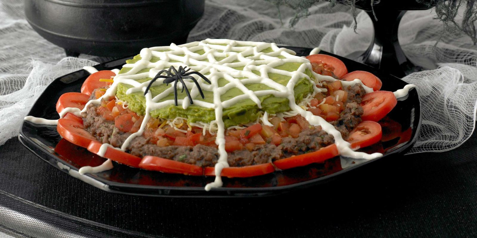Halloween Dips And Spreads  Spiderweb Nacho Spread Recipe for Halloween at Woman s Day