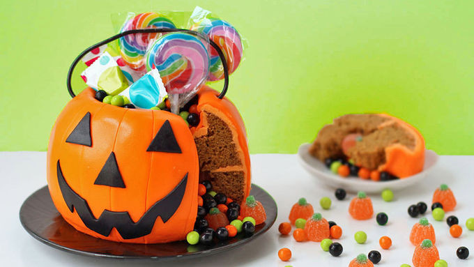 Halloween Pumkin Cakes  Halloween Pumpkin Surprise Cake recipe from Tablespoon