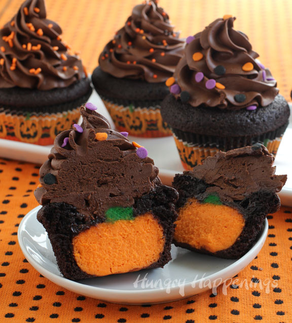 Halloween Pumpkin Cupcakes  Ultimate Cheesecake Stuffed Halloween Cupcakes Hungry